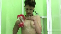 Desirable Rene loves masturbating in the shower while lookin
