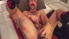 daddy shoves dildos in his hole